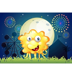 A carnival with a smiling monster near the grass vector image