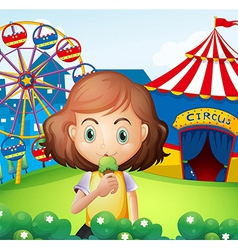 A girl at the carnival eating an icecream vector image vector image