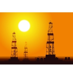 Oil rigs over sunset vector image