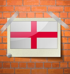 Flags England scotch taped to a red brick wall vector image