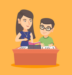 little boy having a piano lesson with a teacher vector image