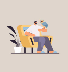 Man with owl guy taking care of pet animal bird vector