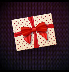 Realistic gift box with red ribbon vector
