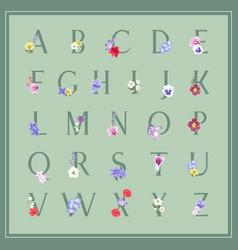 Winter bloom alphabet design with various flowers vector