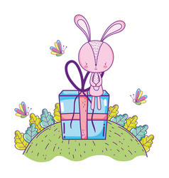 cute little rabbit with giftbox in the landscape vector image