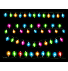 Strings of holiday lights on black background vector image