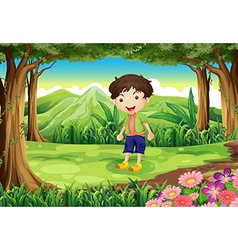 A playful kid at the forest vector image