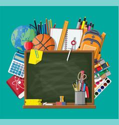 green chalkboard and school supplies vector image