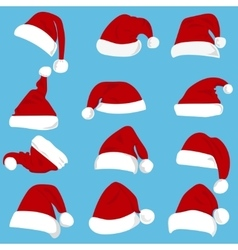 Set of red Santa Claus hats isolated on white vector image
