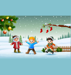 happy kids wearing a winter chlotes playing on the vector image
