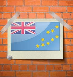 Flags Tuvalu scotch taped to a red brick wall vector image
