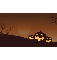 Silhouette of funny pumpkins in fields vector