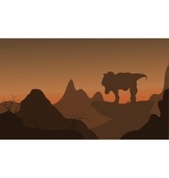 Silhouette of tyrannosaurus standing in rock vector image vector image