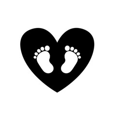 Baby footprints inside of black heart icon vector