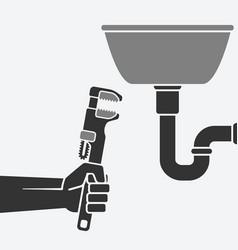 plumber with wrench repairing a leaking pipe vector image vector image