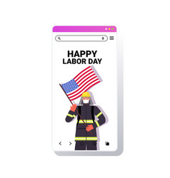 firefighter in uniform holding usa flag labor day vector image