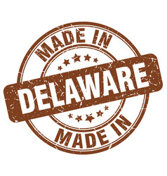Made in delaware brown grunge round stamp vector