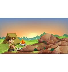 A young boy camping near the rocks vector image vector image