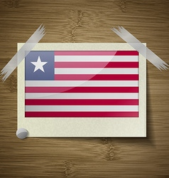 Flags Liberia at frame on wooden texture vector image