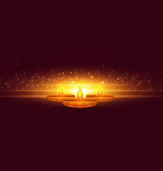 Glowing diwali diya with light sparkle design vector