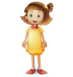 A cute young girl wearing a yellow polka dress vector image vector image