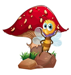 A bee standing at the rock with a mushroom at the vector image
