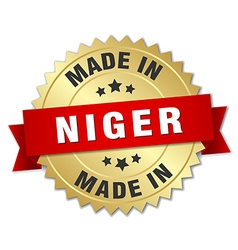 Made in Niger gold badge with red ribbon vector