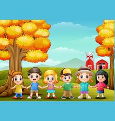 cute children holding hands together in farm backg vector image