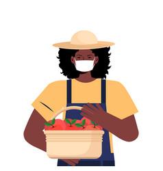 female farmer holding box with fresh apples vector image