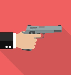 Hand holding handgun vector