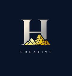 letter h with golden mountain logo de vector image