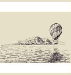 hot air balloon over the sea retro style vector image
