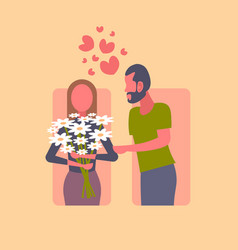 man gives bouquet of white chamomiles flowers to vector image