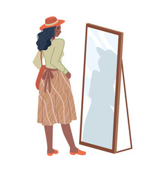 Woman in skirt looking in mirror in fitting room vector