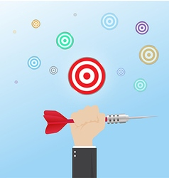 Hand of businessman with Hit the Bullseye vector