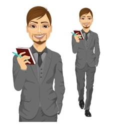 handsome business man holding notebook vector image
