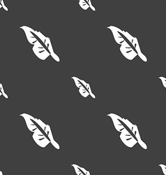 Feather icon sign Seamless pattern on a gray vector image
