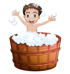 A happy boy taking a bath vector image vector image