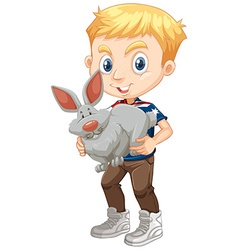 Boy hugging a gray bunny vector