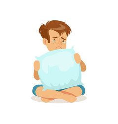 Frustrated sad boy character sitting on the floor vector