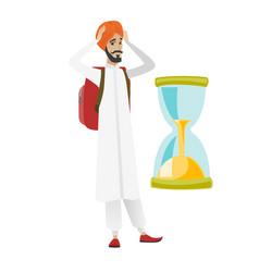 worried hindu traveler man looking at hourglass vector image vector image