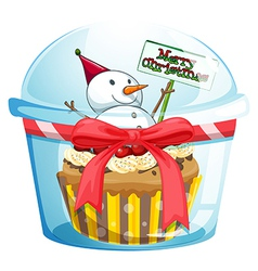 A disposable cup with a cupcake and a snowman vector image