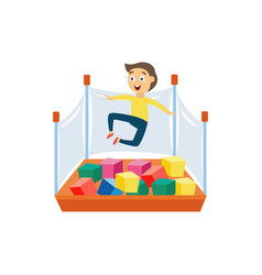 Cartoon boy jumping in foam pit with colorful cube vector