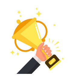 Successful winner holding golden cup in hand vector