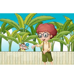 A curly boy near the fence with a monkey vector image