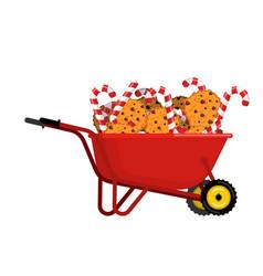 santa claus wheelbarrow cookies and peppermint vector image