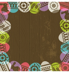 wooden background with frame of easter eggs vector image