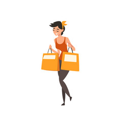 young beautiful cheerful walking woman with bags vector image