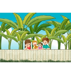 A sad mother with her family at the fence vector image