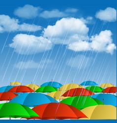 Colorful umbrellas in rain vector
